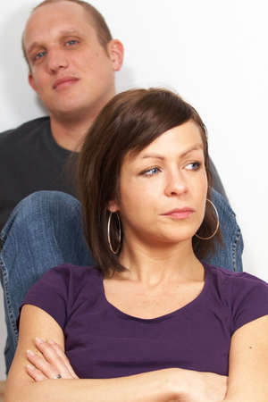 A couple in a dispute. The focus is on the woman in front. Stock Photo - 4044721