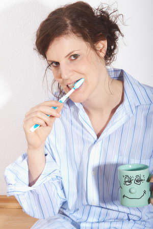 A young woman is brushing her teeth in the morning. Stock Photo - 4141806