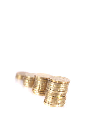 stacked up: Stacked up coins. Isolated over white. Ideal Businesshot.