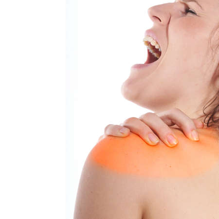 A young woman holds her back in pain! The area on the shoulder is higlighted to symbolize the pain. Stock Photo - 4187816