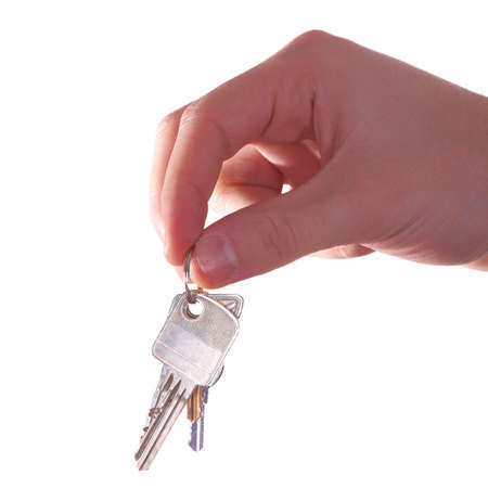 A hand is giving someone a bunch of keys. Isolated over white. Stock Photo - 4187828