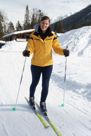 A young woman outdoor in a winter setting. The active woman is about to go crosscountry skiing. photo