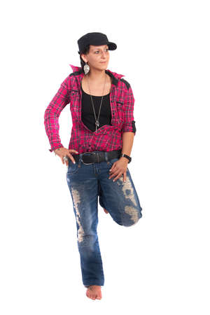 Portrait of a young woman wearing a pink shirt and ripped blue jeans. Stock Photo - 4701493