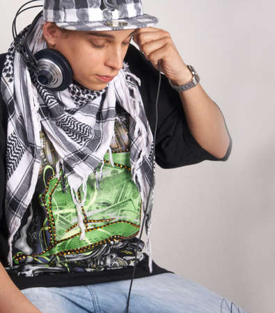 Portrait of a young diskjockey. Isolated over white. photo