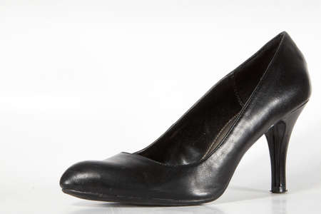 useless: Black womans shoe. Isolated over white with lots of copyspace! Stock Photo
