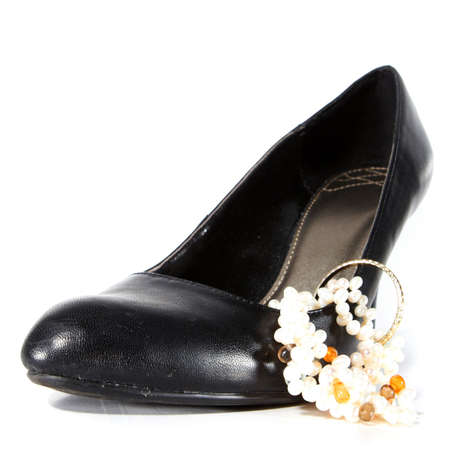 Black woman's shoe with jewelry. Isolated over white with lot's of copyspace! Stock Photo - 5424980