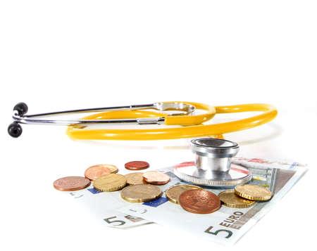 Yellow Stethoscope with money - symbolizing expensive healthcare systems. Highkey image! photo