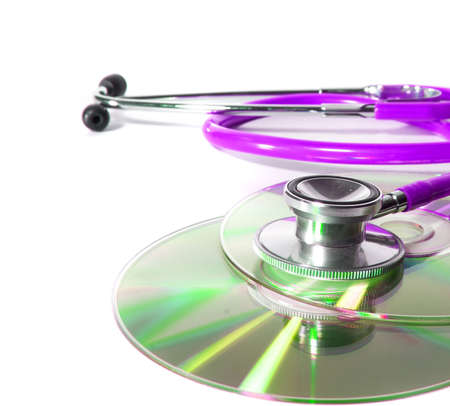 Pink Stethoscope and a cd disk - checking the content of the disk. Could be used for medical and computer purposes! Highkey image! photo