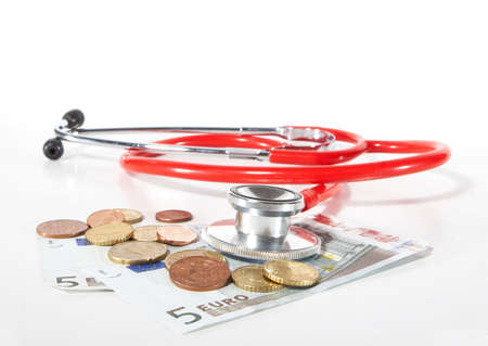 Red Stethoscope with money - symbolizing expensive healthcare systems. Highkey image! photo