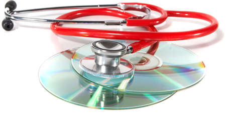Stethoscope and a cd disk - checking the content of the disk. Could be used for medical and computer purposes! photo