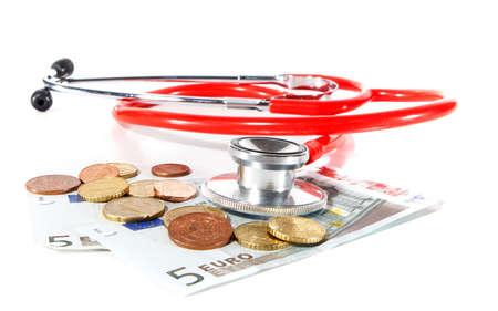 highkey: Red Stethoscope with money - symbolizing expensive healthcare systems. Highkey image! Stock Photo