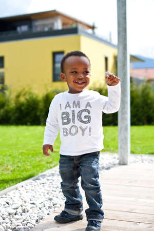 Young baby boy in the garden Stock Photo - 7093815