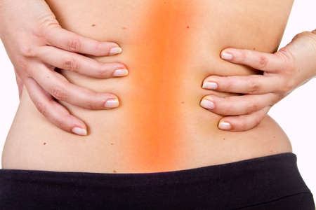 Medical shot showing a woman with pain in her back. Isolated over white. photo