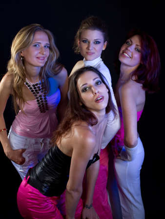 A group of four young fresh women partying. Nice lively image. photo