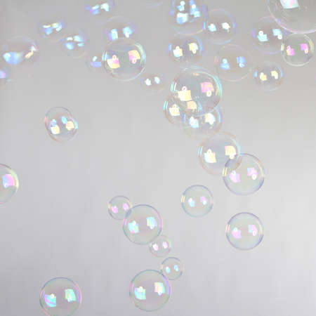 blowing bubbles: Blow Bubbles over a studio background. Lots of them.