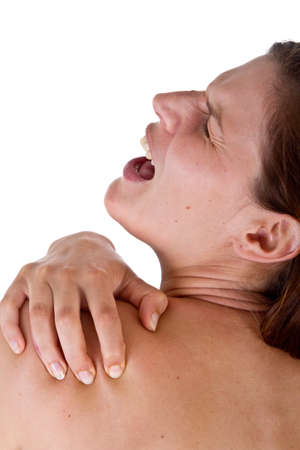 Woman with pain in her neck and shoulder, Isolated medical shot over white background. photo