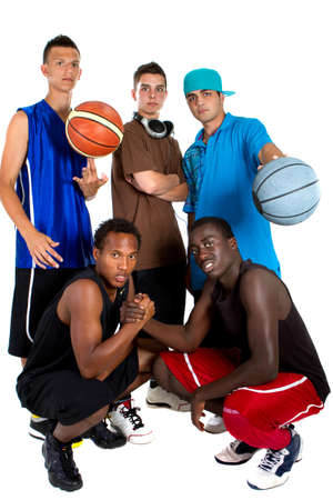 Group of young interracial men posing as a basketball team. Very hip, young and fresh crowd. Stock Photo - 7279797