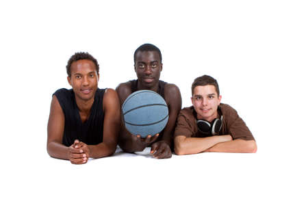 Young interracial group of happy sporty teenagers lying on the floor. Isolate over white. Stock Photo - 7279724