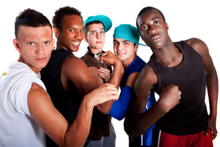 Young group of five teenagers isolated over white. Fresh young men with stylish athletivc outfit. photo