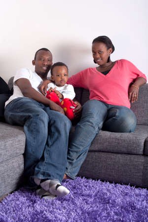 Young afro american family in a living room setting. Stock Photo - 7410216