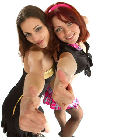 Two beautiful models dancing in a studio setting over white background. photo
