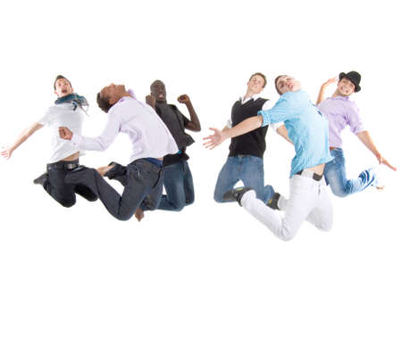 Group of six young stylish teenagers jumping in joy over white background. photo