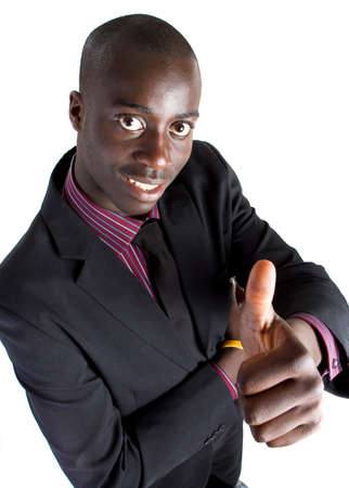 Young black businessman with suit isolated over white background. He is giving a thumbs up sign. Stock Photo - 7471605