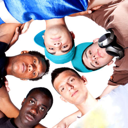 Young group of five teenagers isolated over white. Fresh young men with stylish athletivc outfit. Stock Photo - 7566326