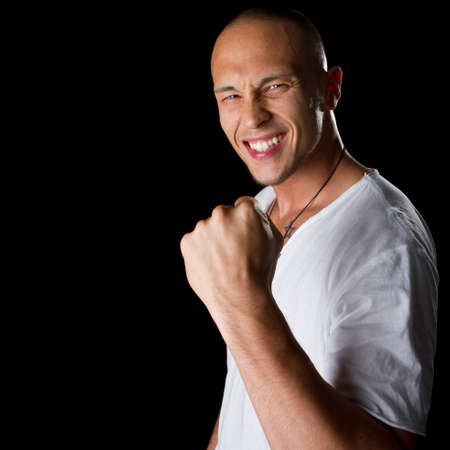 Young male filipino model over a black background is gesturing with his hand. Stock Photo - 7471554
