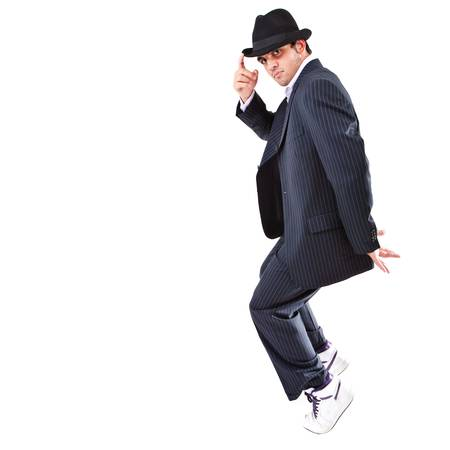 Young stylish teenager is showing dance moves Isolated over white background. photo