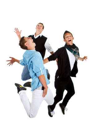 Young group of teenagers with trendy clothes jumping in joy over white background. photo