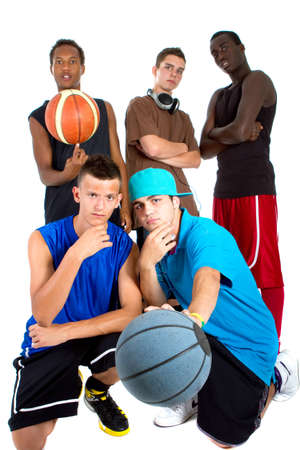 Group of young interracial men posing as a basketball team. Very hip, young and fresh crowd.