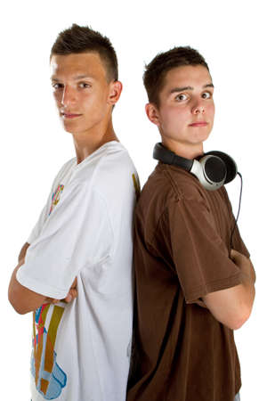 Two young fresh teenagers acting as djs at a party scene. Isolated over white. photo