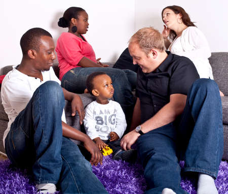 Young group of multiracial friends - two young families enjoying the afternoon. photo
