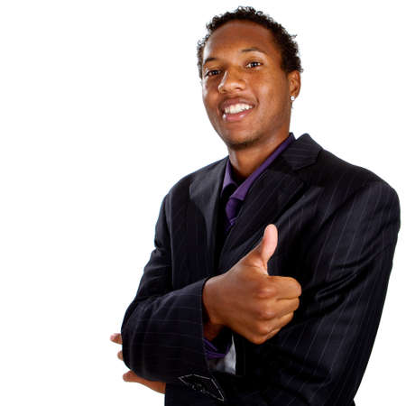thumbs up symbol: Young black businessman with suit isolated over white background. He is giving a thumbs up sign.