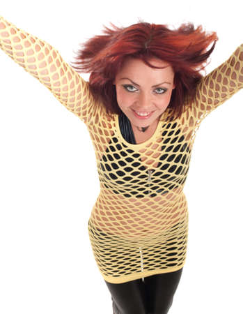 Young beautiful fashion model with red hair and a fishnet shirt. photo