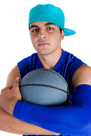 Young teenage basketball player in a studio setting with hip athletic clothing. photo