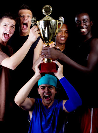 Young fresh group of teenagers with a trophy. They are celebrating. Stock Photo - 7718739