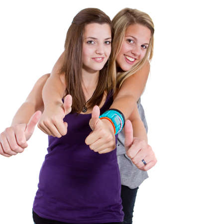 Young teenage girls with stylish clothes isolated over a white background. photo