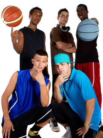 Group of young interracial men posing as a basketball team. Very hip, young and fresh crowd. photo