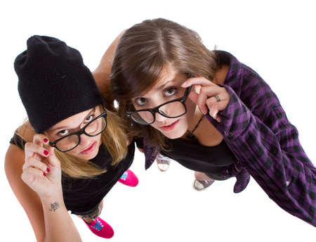 Young trendy teenagers in a nerd  geek style. Isolated over white background. photo