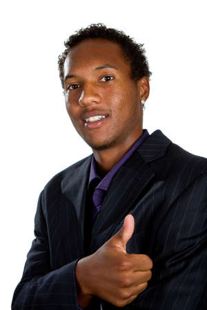 Young black businessman with suit isolated over white background. He is giving a thumbs up sign. Stock Photo - 7947600