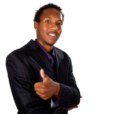 Young black businessman with suit isolated over white background. He is giving a thumbs up sign. photo