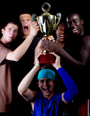 Young fresh group of teenagers with a trophy. They are celebrating. photo