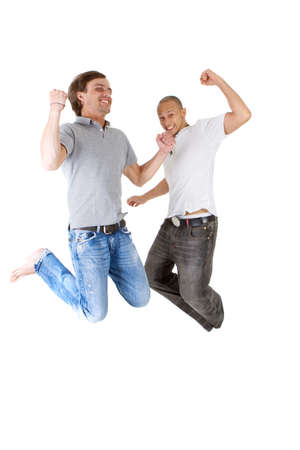 Two young successfull jumping in joy! Two handsome multiracial models. photo