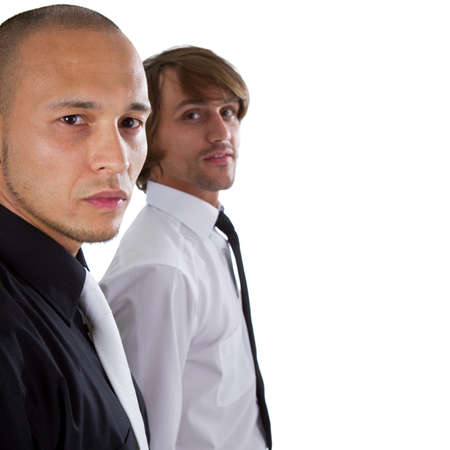 Two young businessman - one asian and one caucasian isolated over white background. photo