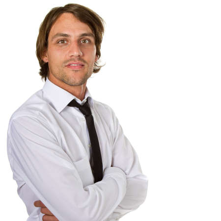 Young businessman isolated over white background with a black tie and longer hair. photo