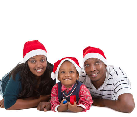 Young black family with a little boy are getting ready for christmas. Happy and cute image. Stock Photo