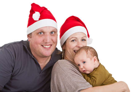 Young happy family with a baby girl getting ready for chirstmas. Stock Photo - 8158221