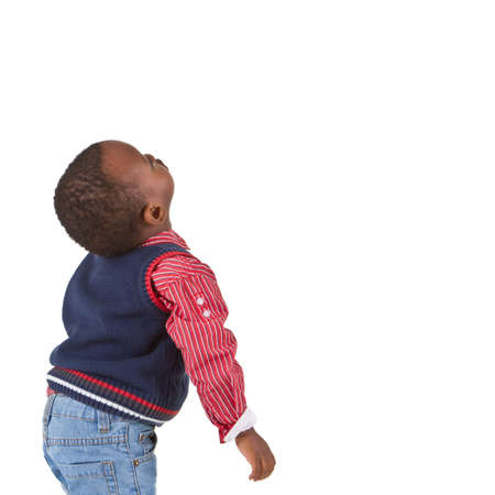 Young black baby boy looking up. Isolated over white background. photo